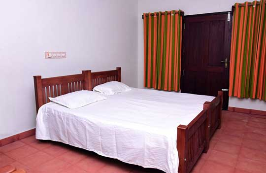 Thottada-Beach-House-Heritage-Home-Interior-Deluxe-Bedroom-home